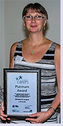 Kim Munro with 2018 Platinum Carers' Award presented to Whiteparish Surgery
